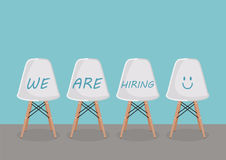 WE ARE HIRING texts on the chairs. Recruitment concept Stock Images