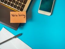 We are hiring to be message in the letter  on the blue background royalty free stock photography