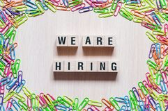 We are hiring words concept. On cubes royalty free stock photography