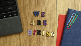 We are hiring. Written at the office stock image