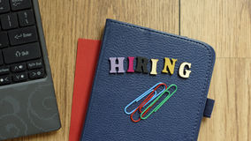 Hiring. Written at the office Stock Images