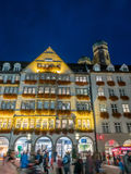 Hirmer shop builiding in Munich. MUNICH - OCTOBER 14 : Hirmer shop building on Kaufinger street under twilight evening sky in Munich, Germany, on October 14 Royalty Free Stock Image