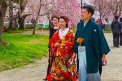 Unidentified Japanese gloom and bride at Hirosaki park. Unidentified Japanese gloom and bride attend a Japanese traditional wedding ceremony at Hirosaki Park in stock image