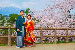 Unidentified Japanese gloom and bride at Hirosaki park. Unidentified Japanese gloom and bride attend a Japanese traditional wedding ceremony at Hirosaki Park in stock images