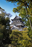 Hiroshima Castle. MS: The tower of the Hiroshima castle in Japan; framed by Japanese maples in spring time.  Very typical of Japanese architecture, this castle Royalty Free Stock Images