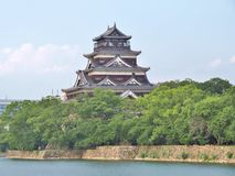Hiroshima Castle in Hiroshima, Japan. Hiroshima Castle on the side of Otagawa river in summer. The castle was destroyed by the atomic bombing on August 6, 1945 Royalty Free Stock Image