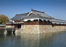 Hiroshima Castle moat. MS: The moat defending the Hiroshima castle in Japan;  Very typical of Japanese architecture of the period this castle was defended by Royalty Free Stock Photography