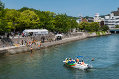 Hiroshima city. Hiroshima, Japan - May 5, 2016: Gangi boat taxi crossing Motoyasu River near Hiroshima Peace Memorial park in Hiroshima Prefecture, Chugoku royalty free stock images