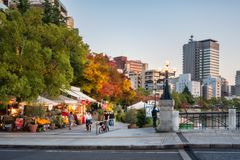 Hiroshima Cityscape at sunset in autumn, Japan. Horoshima, Japan -November 6, 2018: Hiroshima Cityscape at sunset in autumn, with a few shops and take away royalty free stock image