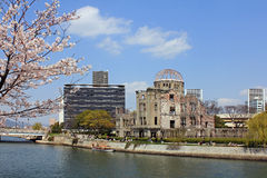 Hiroshima A-Dome with Sakura stock images