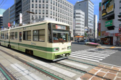 Hiroshima Electric Railway. Being located on a delta, Hiroshima opted to keep their tram line in the 1980's while other cities in Japan abandoned them for subway Royalty Free Stock Photography