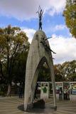 HIROSHIMA, JAPAN - APRIL 01, 2019: Tourists visiting Children`s Peace Monument, to commemorate Sadako Sasaki. And the children victims of the atomic bombing stock image