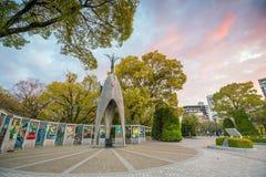 The Children`s Peace Monument in Hiroshima Peace Memorial Park, Japan. HIROSHIMA, JAPAN - MARCH 24, 2019: The Children`s Peace Monument with a statue of a girl royalty free stock photos