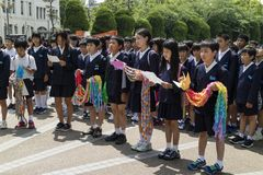 Hiroshima, Japan - May 25, 2017: Students gathering at the Child. Ren`s Peace Monument to offer thousands colorful origami cranes in memory of atomic bombing Stock Photo