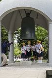 Hiroshima, Japan - May 25, 2017: Students ringing the peace bell Royalty Free Stock Photo
