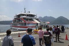 Hiroshima, Japan -  May 26, 2017: Tourists embark on the ferry a. T port Miyajimaguchi to travel to Miyajima island Royalty Free Stock Images
