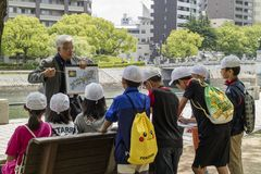 Hiroshima, Japan - May 25, 2017: Volunteer teacher is telling a Royalty Free Stock Photos