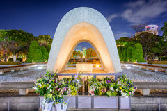 Hiroshima Peace Park. HIROSHIMA, JAPAN - DECEMBER 5, 2012: The Cenotaph Memorial at Hiroshima Peace Memorial Park Stock Image