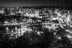 Hiroshima View in black and white from above at Orizuru Tower, Japan. View from above from Orizuru Tower of Hiroshima Cityscape by night on the side of Motoyasu stock photos