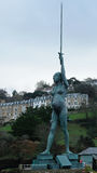 Hirst statue in Ilfracombe harbour in Devon, UK. ILFRACOMBE, ENGLAND - DECEMBER 15, 2016: The 20 metre tall steel and bronze statue, known as Verity and royalty free stock image