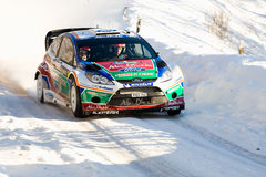 Hirvonen. HAGFORS, SWEDEN - FEB 10: Mikko Hirvonen drivning his Ford Fiesta RS WRC during the World Rally Championship event Rally Sweden in Hagfors, Sweden on Royalty Free Stock Image
