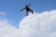 His active sport lifestyle . Mixed media. Snowboard rider jumping against blue cloudy sky Stock Photos