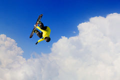 His active sport lifestyle . Mixed media. Snowboard rider jumping against blue cloudy sky Royalty Free Stock Photos