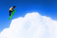His active sport lifestyle . Mixed media. Snowboard rider jumping against blue cloudy sky Royalty Free Stock Images