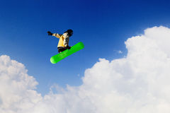 His active sport lifestyle. Snowboard rider jumping against blue cloudy sky Royalty Free Stock Image