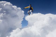 His active sport lifestyle. Snowboard rider jumping against blue cloudy sky Stock Photo