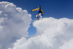 His active sport lifestyle. Snowboard rider jumping against blue cloudy sky Royalty Free Stock Photography