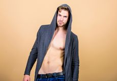 His body is perfect. fitness dieting for good shape. Guy fashion model. man in trendy hooded jacket. sexy macho in denim. Style. perfect torso body of muscular royalty free stock photo