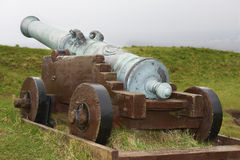 His cannon on the fortress in Torshavn. Old cannon on the fortress in Torshavn in the Faroe Islands Royalty Free Stock Photography