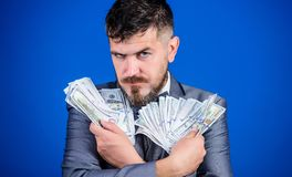 His cash holdings. Bearded man holding cash money. Currency broker with bundle of money. Rich businessman with us. Dollars banknotes. Making money with his own stock images