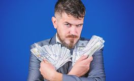 His cash holdings. Bearded man holding cash money. Currency broker with bundle of money. Rich businessman with us royalty free stock photo