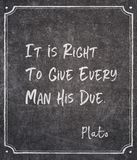 His due Plato quote. It is right to give every man his due - ancient Greek philosopher Plato quote written on framed chalkboard royalty free stock photos