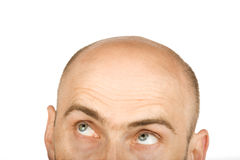 His eyes went up in dispair. Hairless isolated man with green eyes on white background Stock Photo