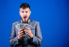 His first salary. Currency broker with bundle of money. Bearded man holding cash money. Rich businessman with us dollars. Banknotes. Making money with his royalty free stock images