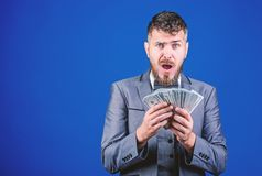 His first salary. Currency broker with bundle of money. Bearded man holding cash money. Rich businessman with us dollars. Banknotes. Making money with his stock photos