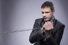 His hands are in chains Stock Photos