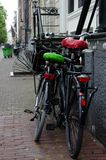 His and Her bikes after rain in Amsterdam Royalty Free Stock Image