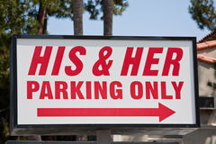 His & Her Parking Only Sign stock photo