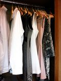 His and her wardrobe in the same rack royalty free stock photos