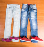 His and Hers Blue Jeans Laid with Shoes Stock Photos