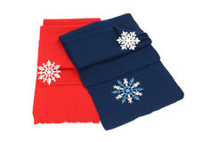 His and hers scarf nicely folded. Red and dark blue scarf decorated with snowflakes isolated on white background Royalty Free Stock Image