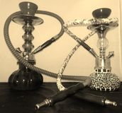 His and hers shisha pipes Royalty Free Stock Image