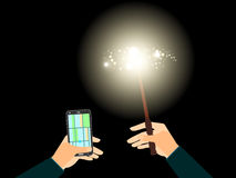 In his left hand phone with navigation, the right magic wand with a bright light illuminates the path. Royalty Free Stock Images