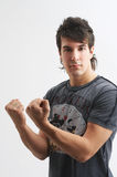 His muscles. One handsome, young man is showing us his muscles royalty free stock photo