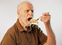 Senior Male Eating Food Royalty Free Stock Photo