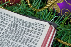 Holy Bible on Christmas garland and ornament Royalty Free Stock Photography